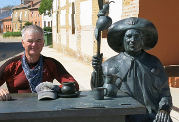 John poses along the Camino with a bronze friend.